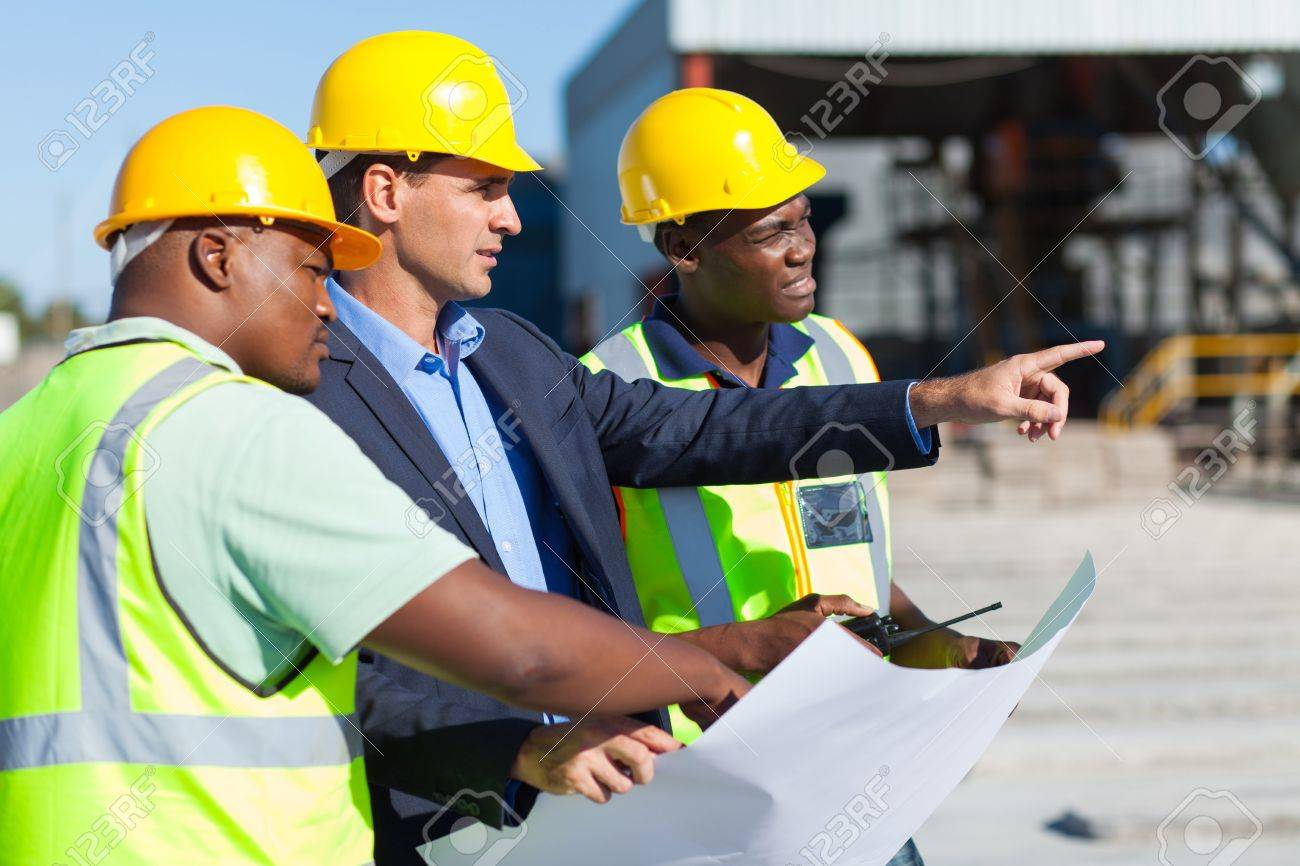 group of architect and construction workers on site with blue