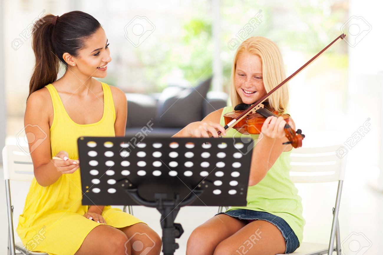 Beautiful Music Teacher Tutoring Young Girl To Play Violin Stock ...