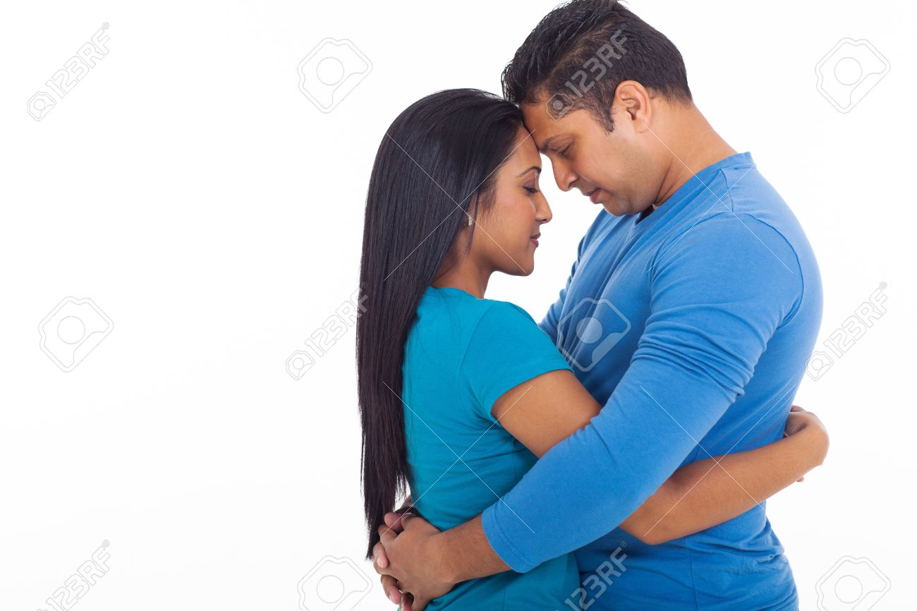 Stock Photo   loving young indian couple hugging with eyes closed on white  background. Loving Young Indian Couple Hugging With Eyes Closed On White