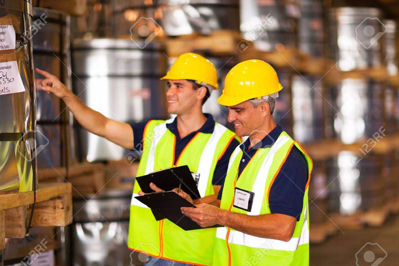 shipping company co-workers counting counting stock in warehouse Stock Photo - 20669062