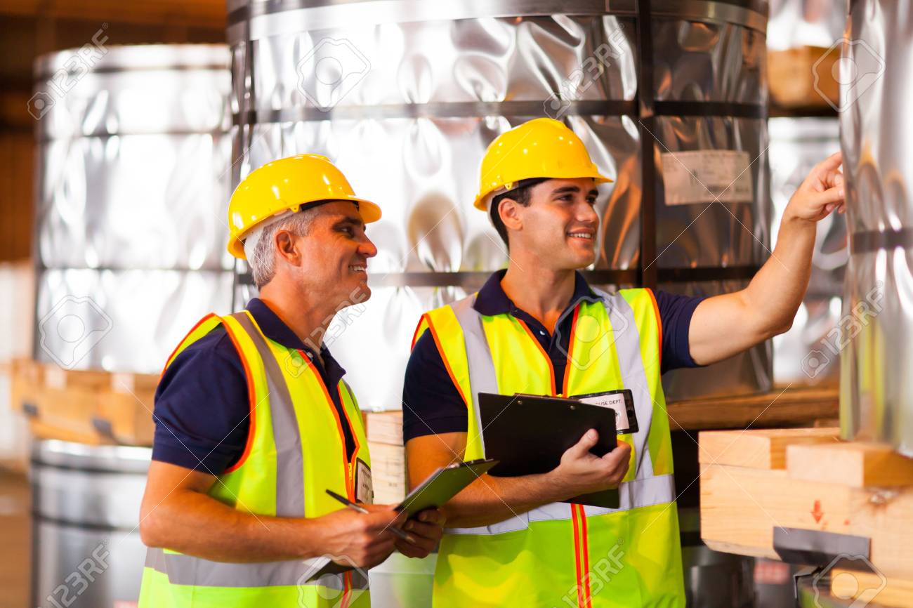 smiling male warehouse workers counting stock Stock Photo - 20665675