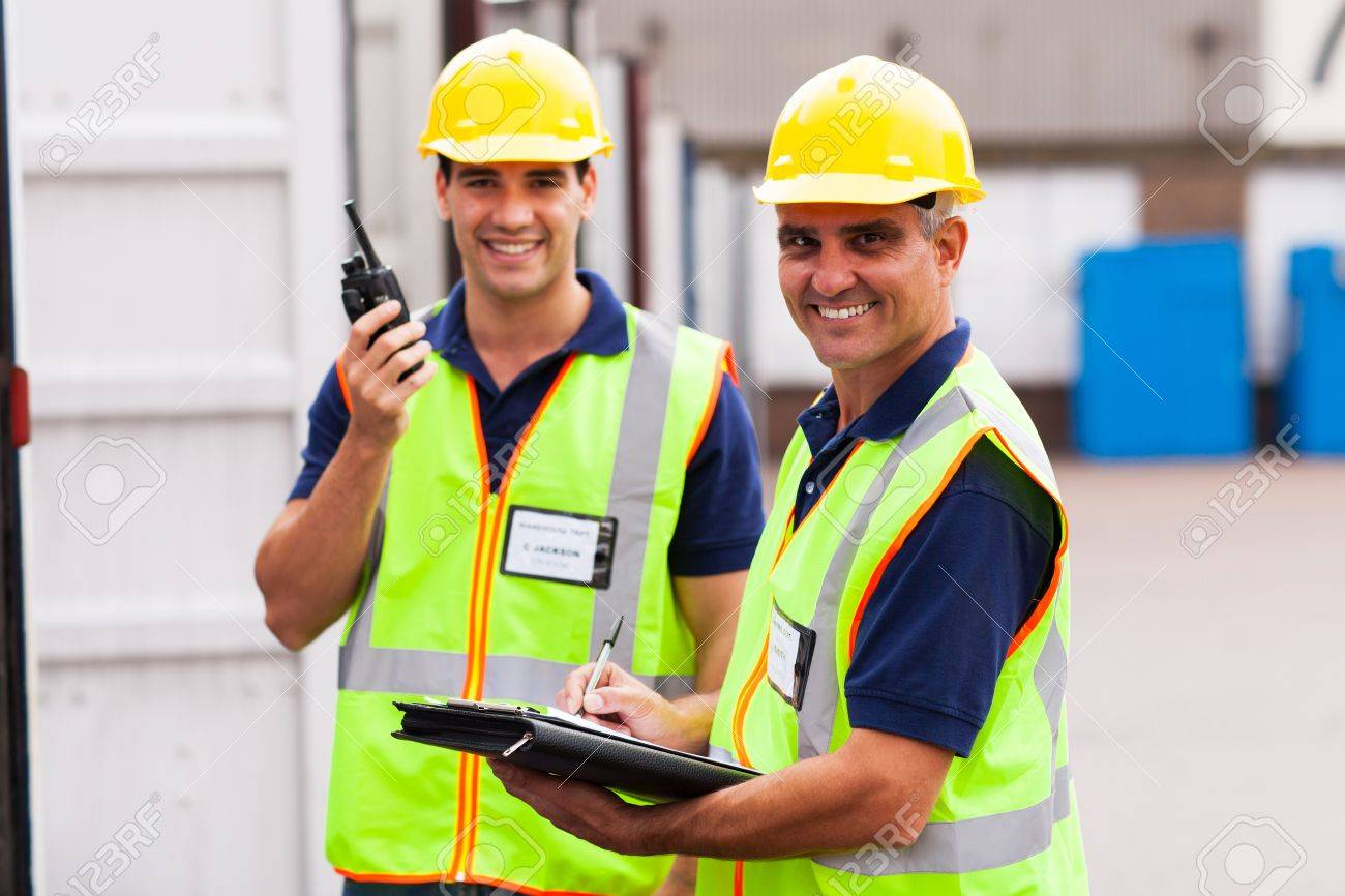 happy senior warehouse worker and colleague Stock Photo - 20659931