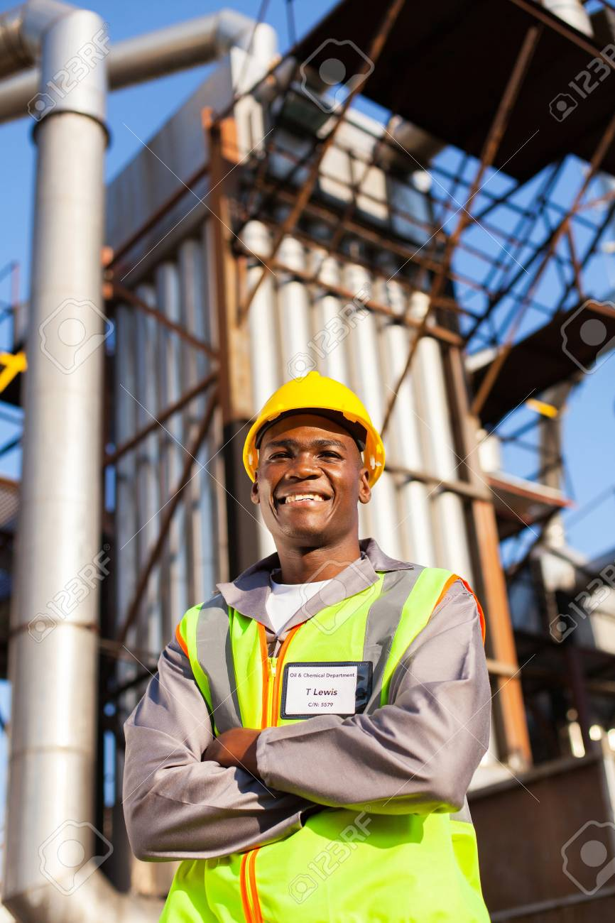 cheerful afro american oil industrial worker with arms crossed in refinery plant Stock Photo - 20660289
