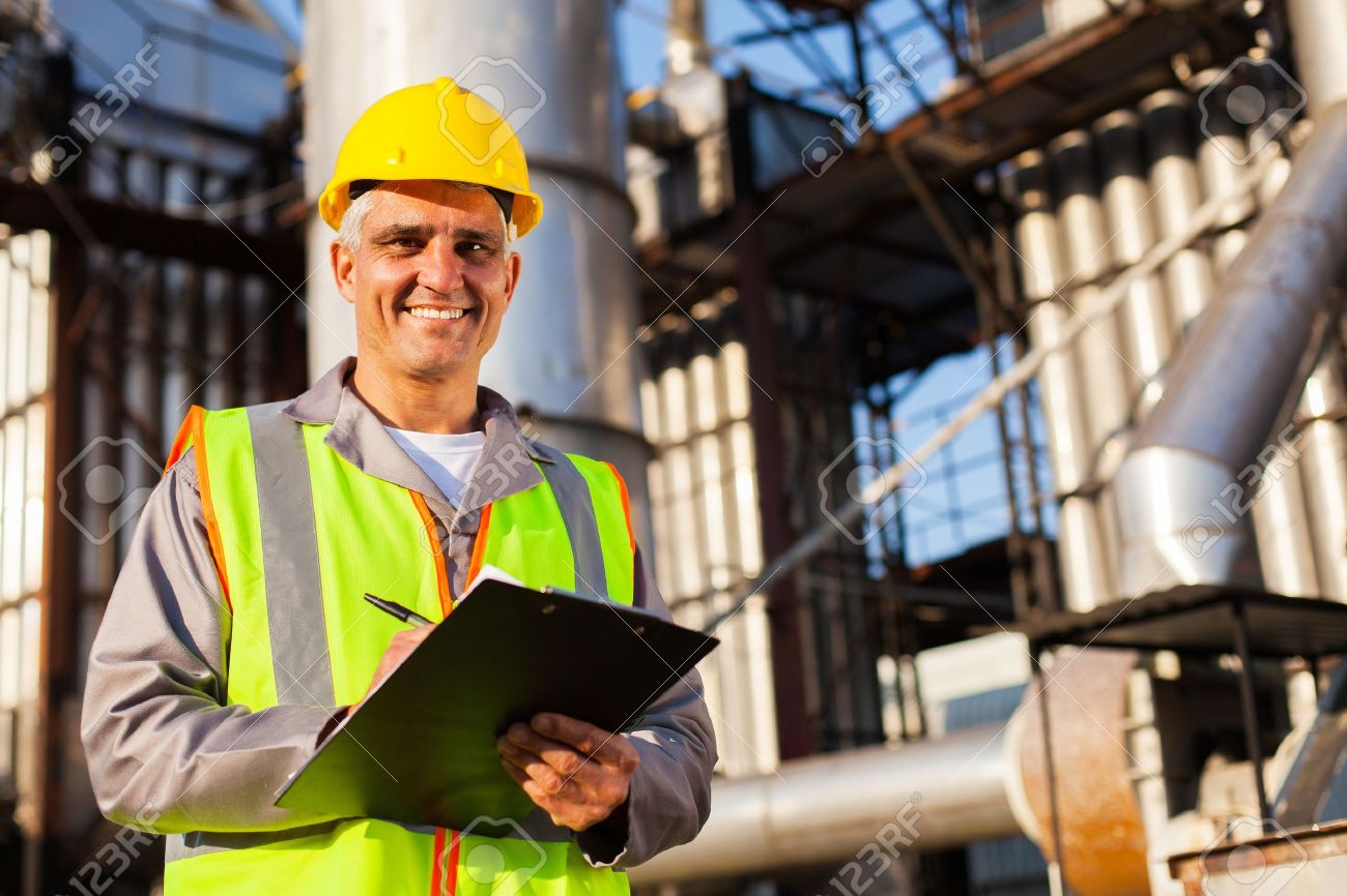 happy middle aged oil industry worker in refinery plant Stock Photo - 20660919