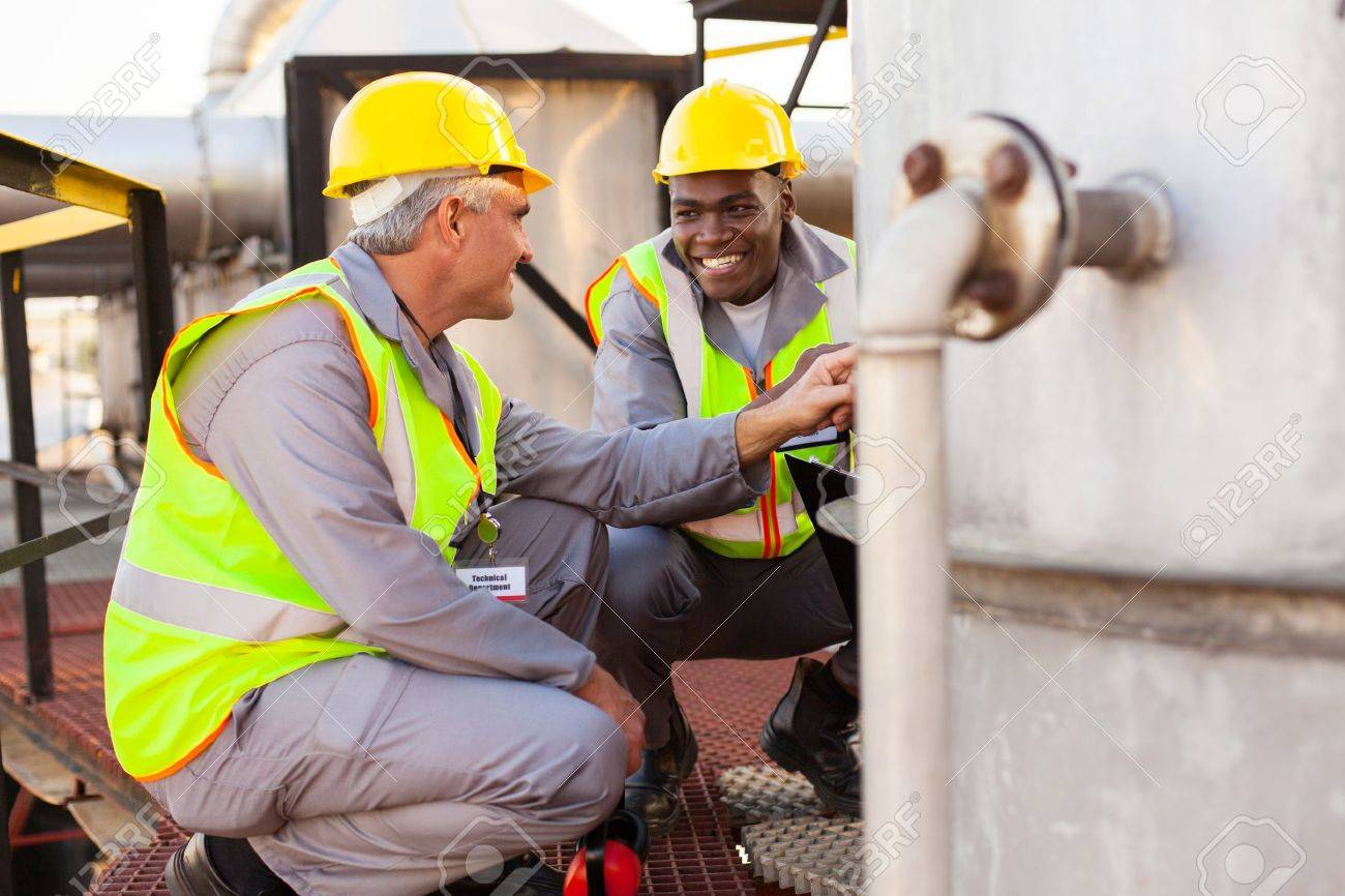 two oil chemical industry technicians working in plant Stock Photo - 20651055