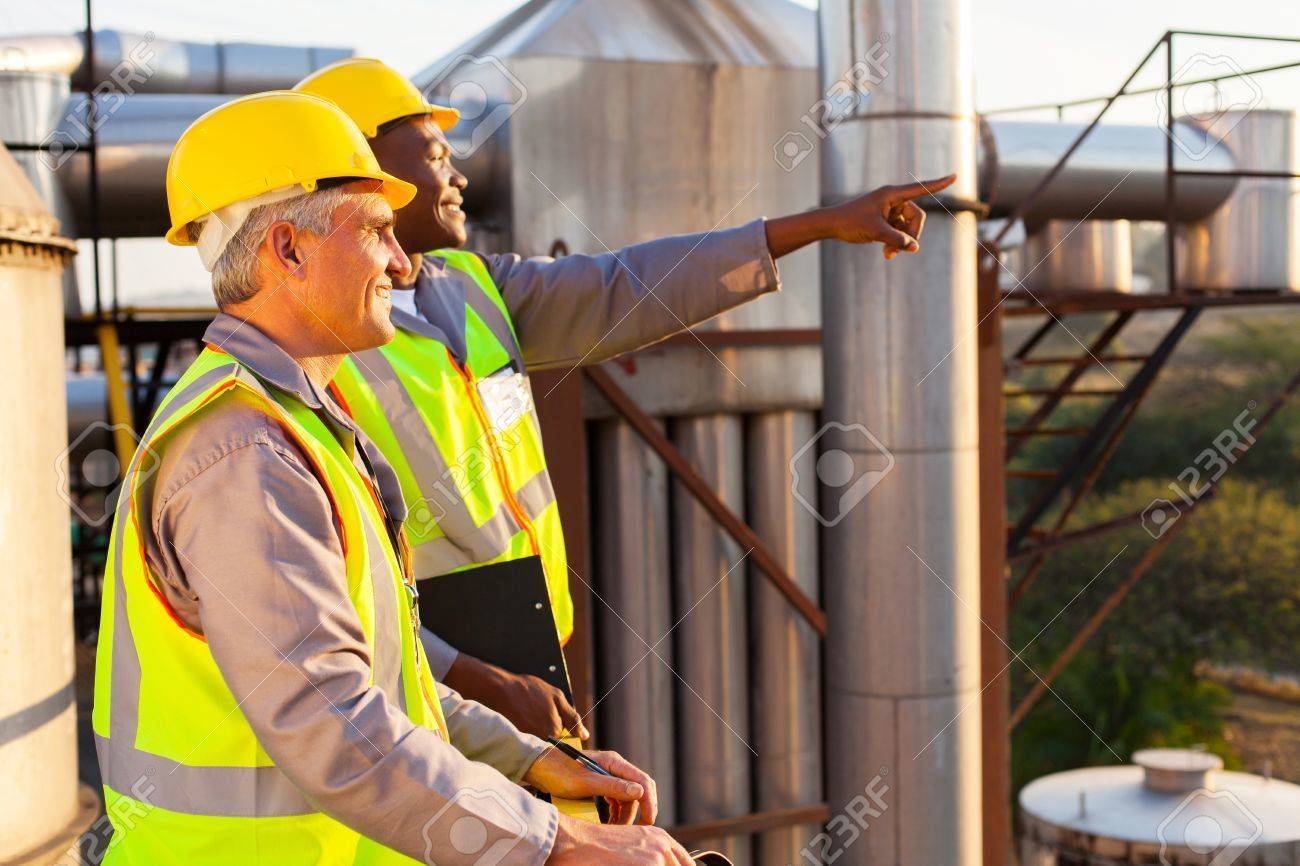 two chemical factory workers working in plant Stock Photo - 20651061
