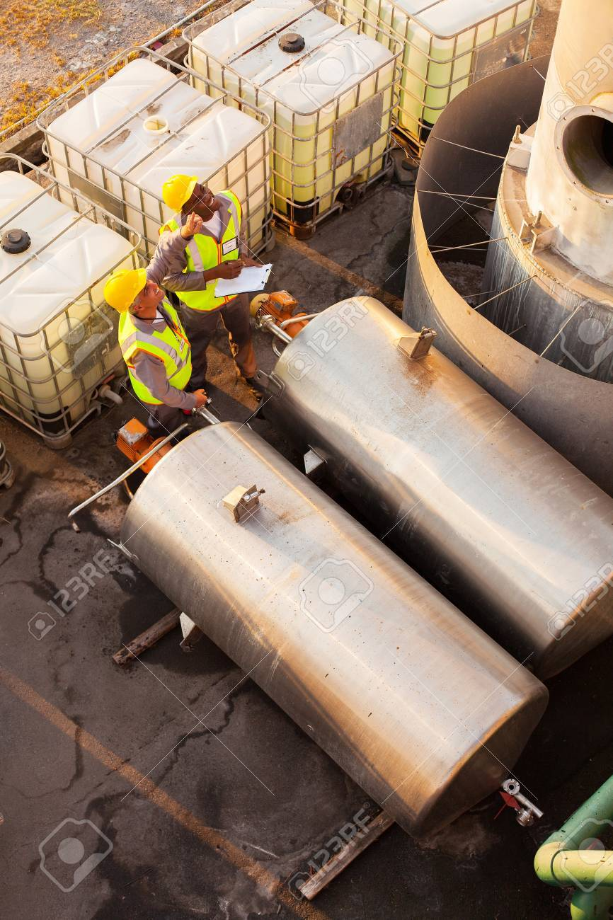 two petrochemical co-workers working in plant looking Stock Photo - 20651051