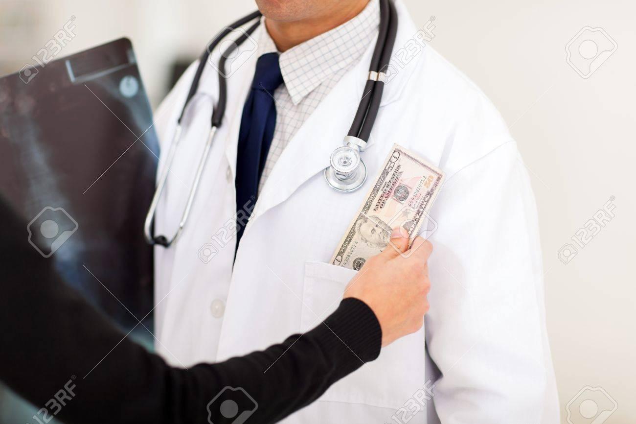 pharmaceutical s rep bribing doctor putting money in his stock photo pharmaceutical s rep bribing doctor putting money in his pocket