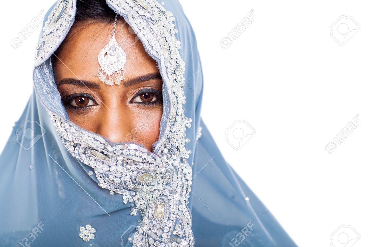 traditional Indian woman in sari covering her face with veil Stock Photo - 21123023