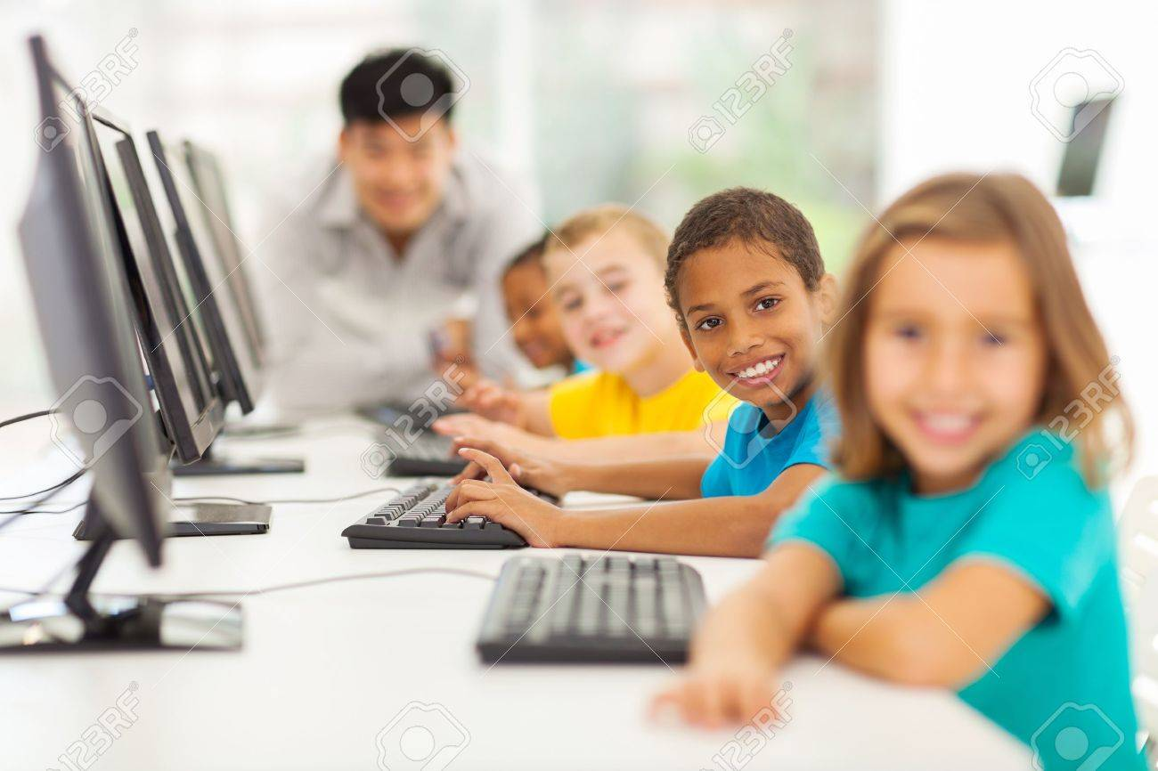 smiling group children in computer class with teacher on background Stock Photo - 21191582