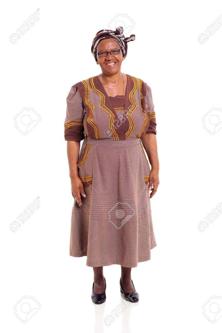 happy elderly african woman in traditional attire standing on..