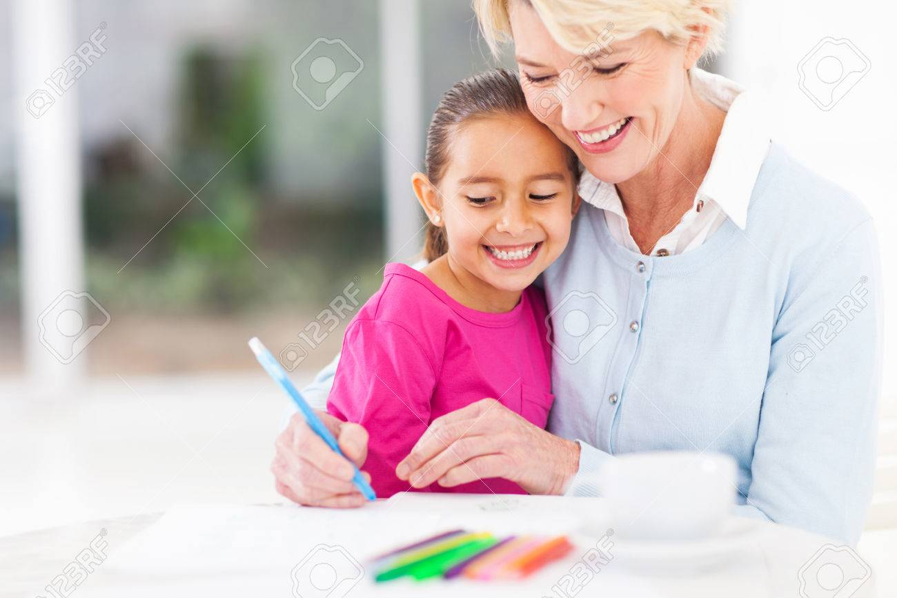 happy senior grandmother teaching her granddaughter how to draw at home Stock Photo - 22889901