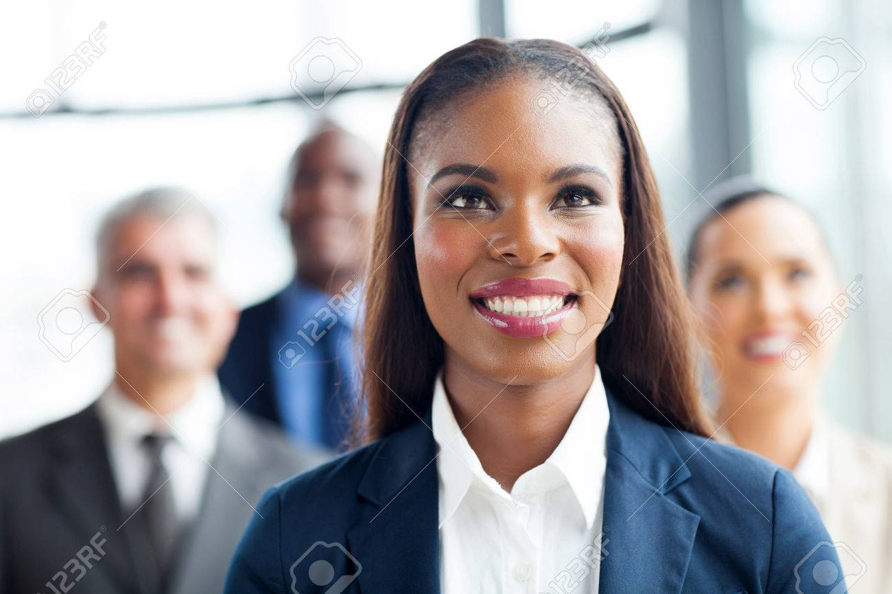 attractive afro american businesswoman and team looking up Stock Photo - 23152780