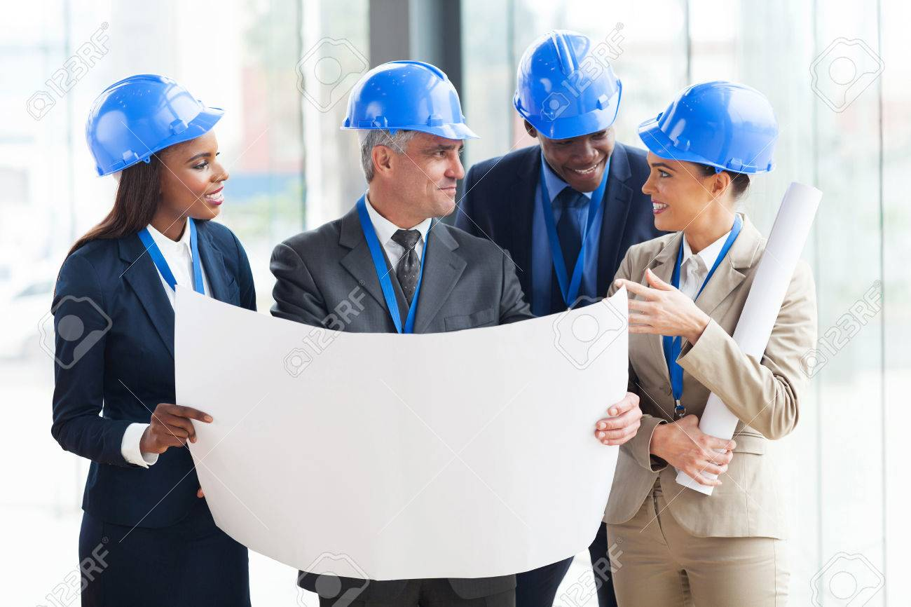 team of successful architects interacting in office Stock Photo - 23152979