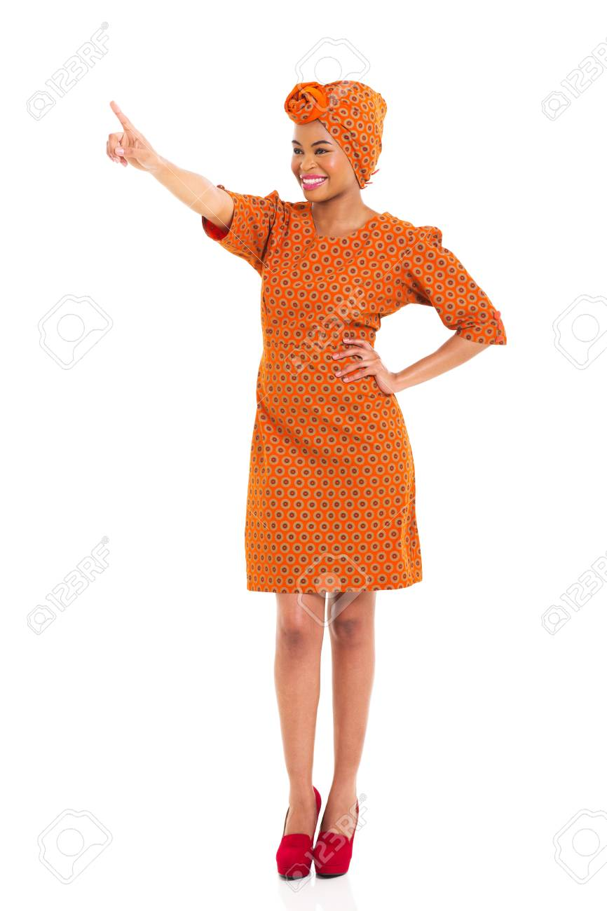 beautiful african woman pointing copy space on white background Stock Photo - 24398184
