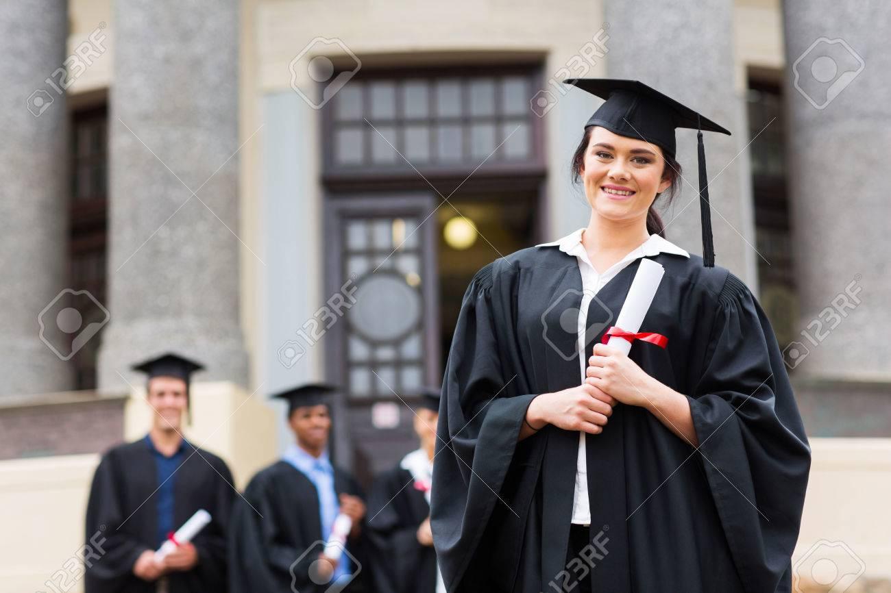 Portrait Of Pretty Female Graduate Wearing Graduation Gown At ...