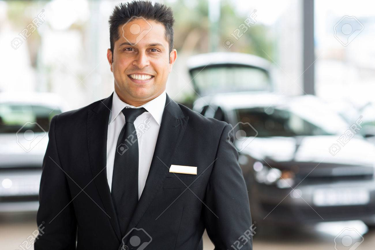 Happy Young Indian Car Salesman In Showroom Stock Photo, Picture ...