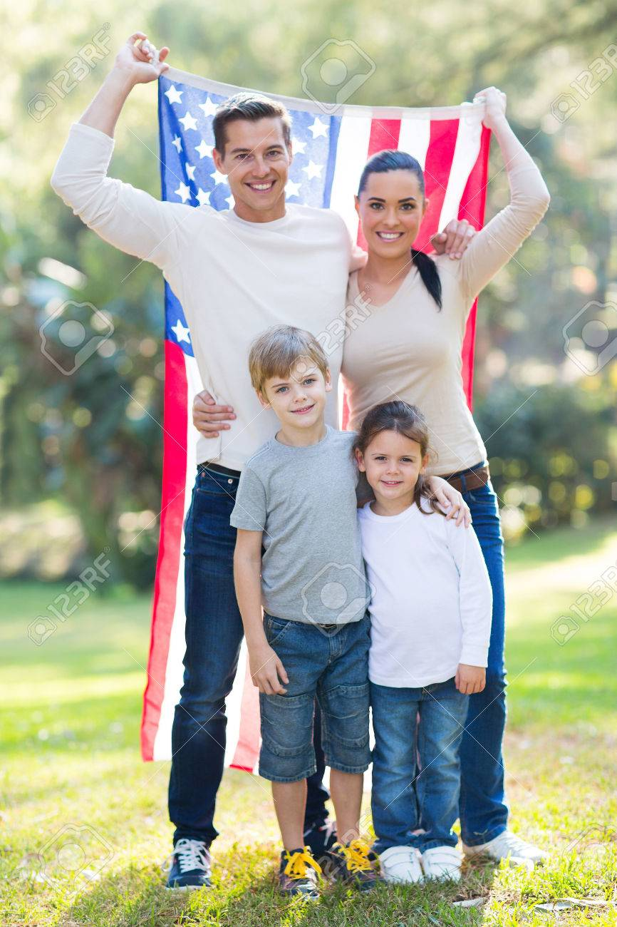 American family of four with usa flag outdoors stock photo 28965213
