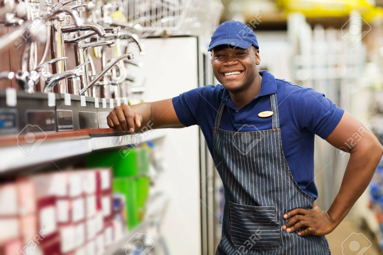portrait of cheerful african hardware store worker stock photo portrait of cheerful african hardware store worker