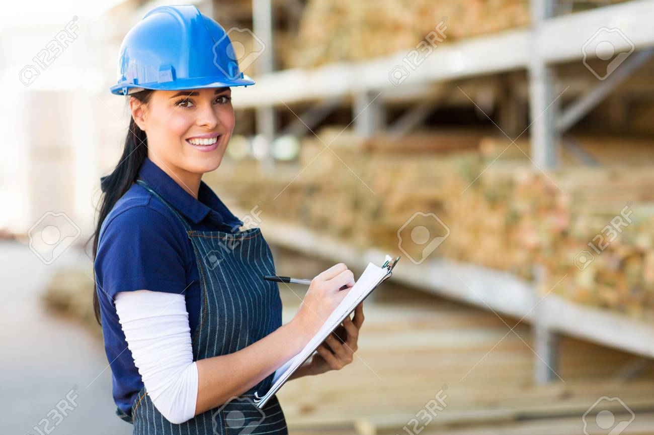 pretty female hardware store worker working in warehouse stock stock photo pretty female hardware store worker working in warehouse