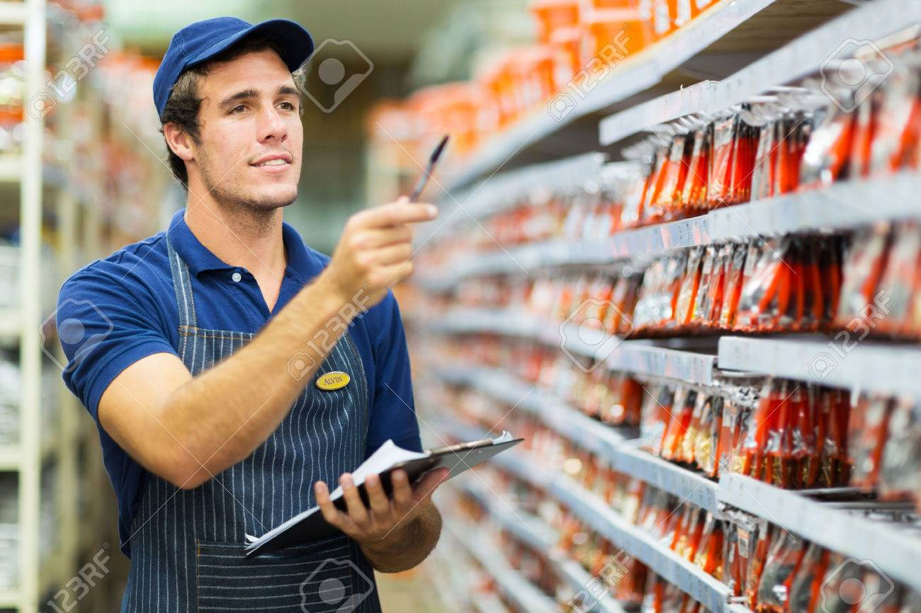 good looking hardware store worker counting stock stock photo stock photo good looking hardware store worker counting stock