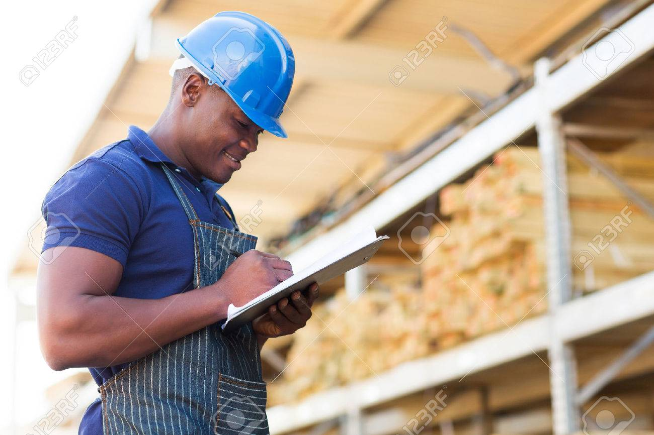 african hardware store worker taking stock stock photo picture stock photo african hardware store worker taking stock