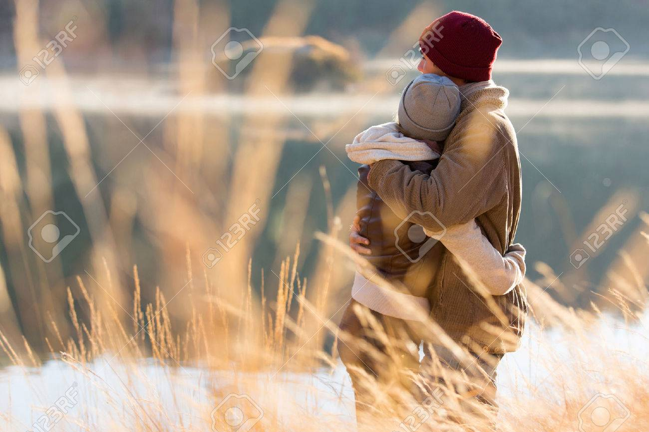 back view of lovely young couple hugging in winter - 30591338