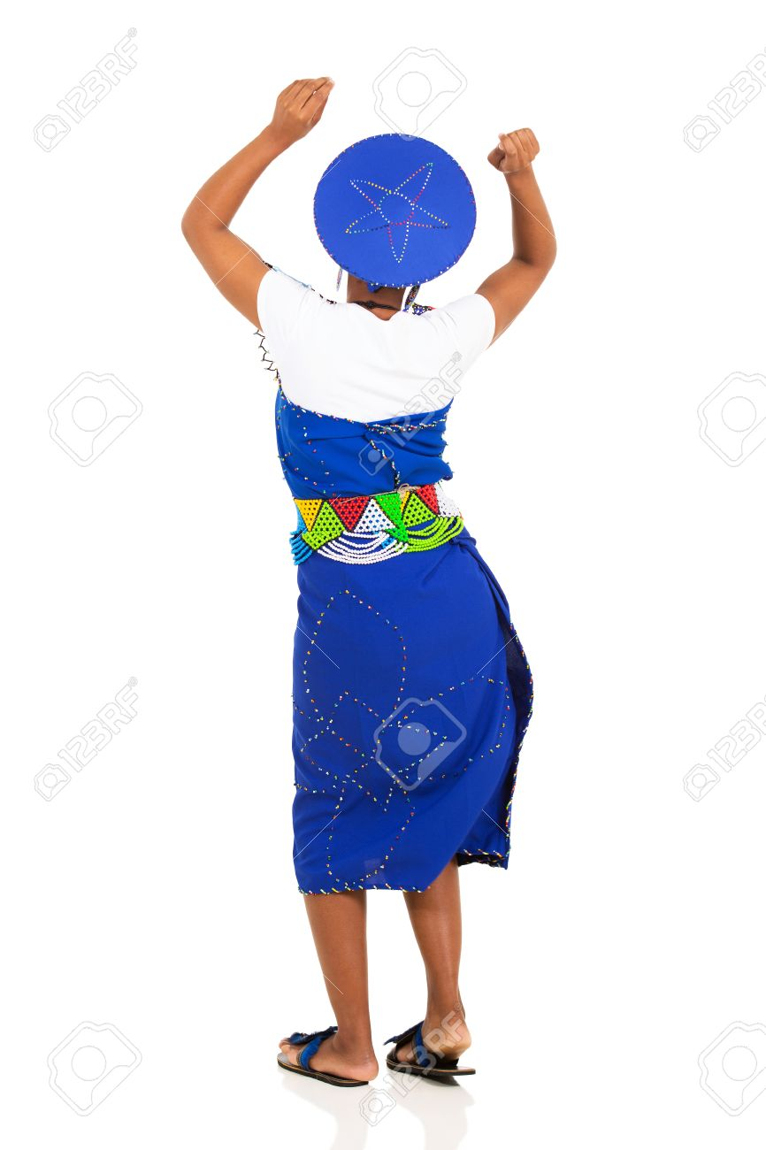 rear view of south african woman in traditional attire dancing