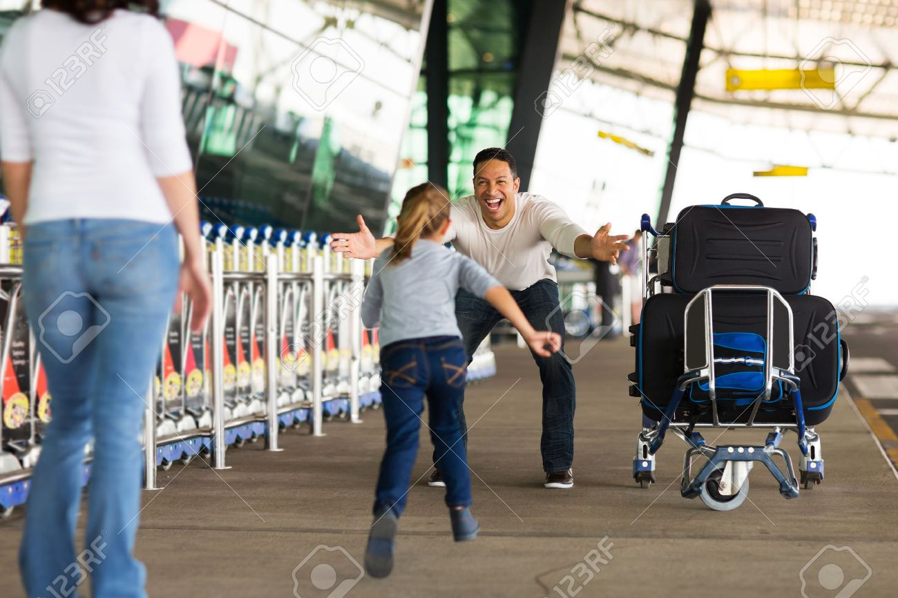 happy family reunion at airport - 30771881