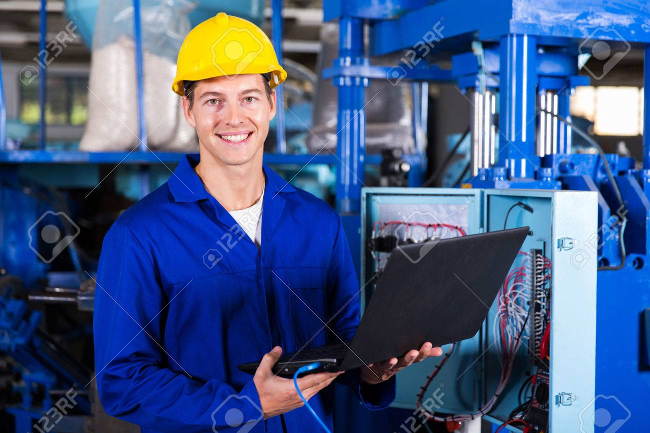 portrait of male engineer with laptop computer in factory - 32755830