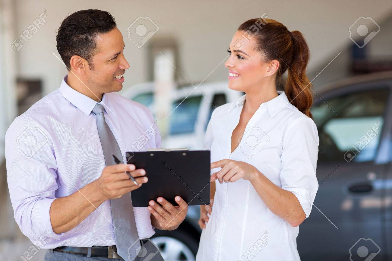 s associate stock photos images royalty s associate s associate two happy car s consultants working inside vehicle showroom