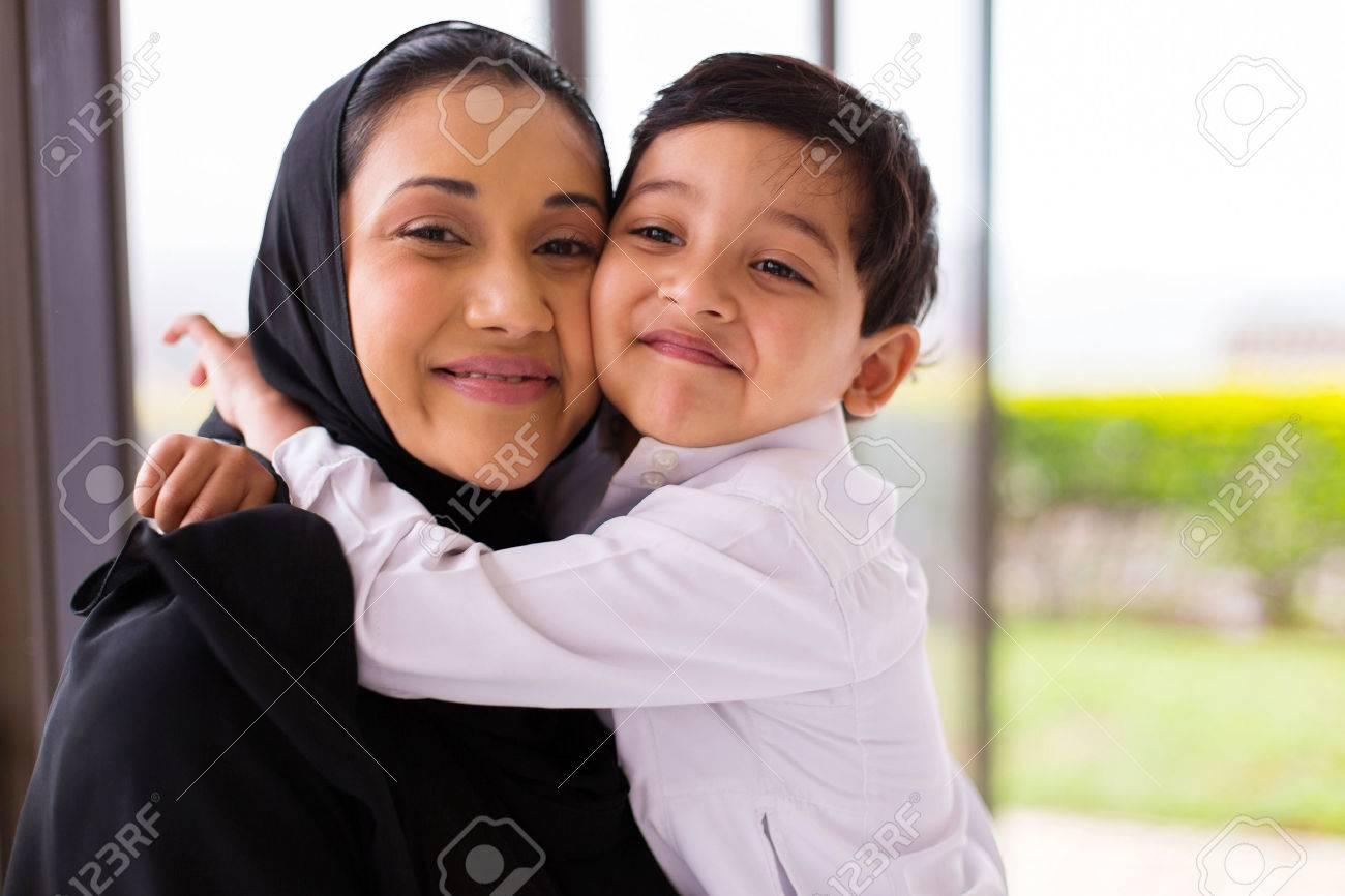 cute muslim boy hugging his mother - 49813084