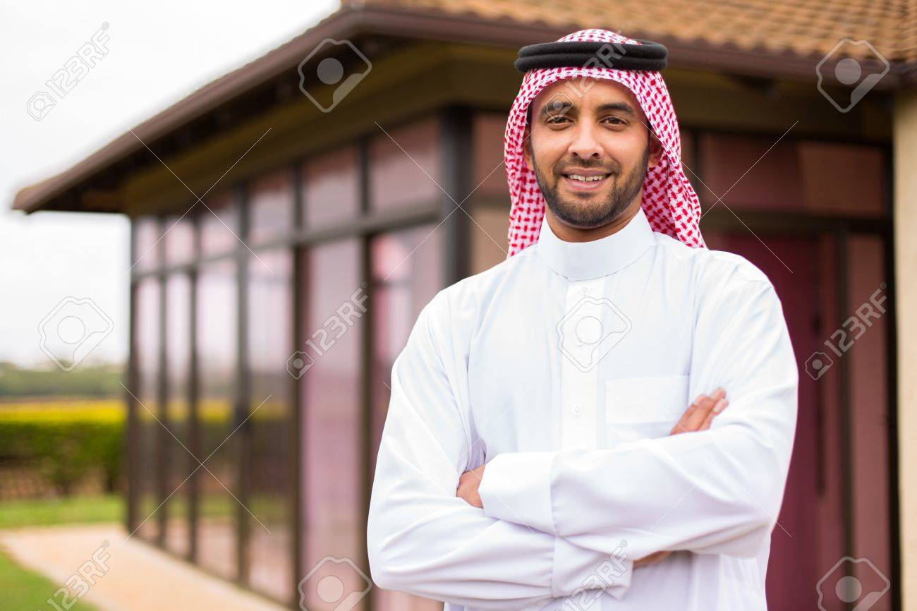 Modern Young Arabian Man With Arms Crossed Outside His House