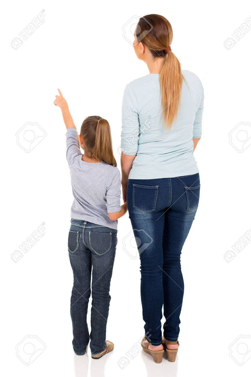 rear view of young mother and daughter pointing at empty space - 50864685