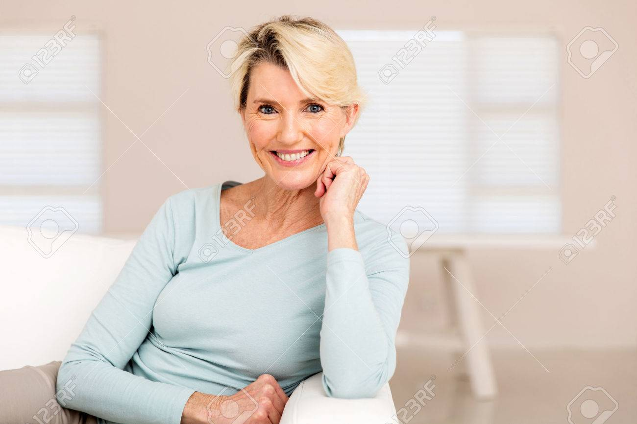 pretty mid age woman relaxing at home - 53030113