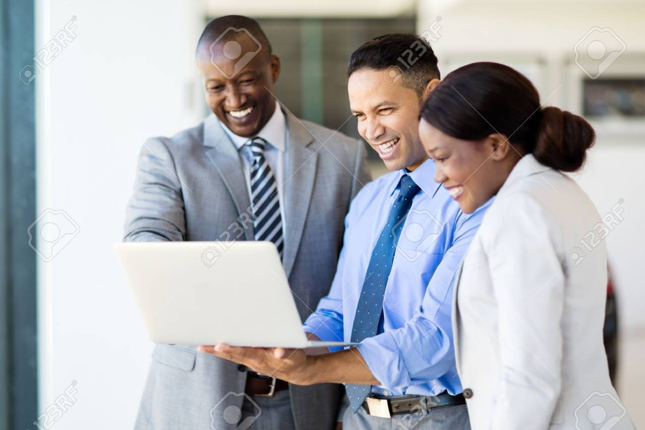 successful multiracial businesspeople using laptop computer - 53100346