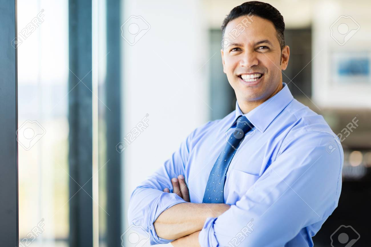 Handsome Middle Aged Office Worker With Arms Crossed