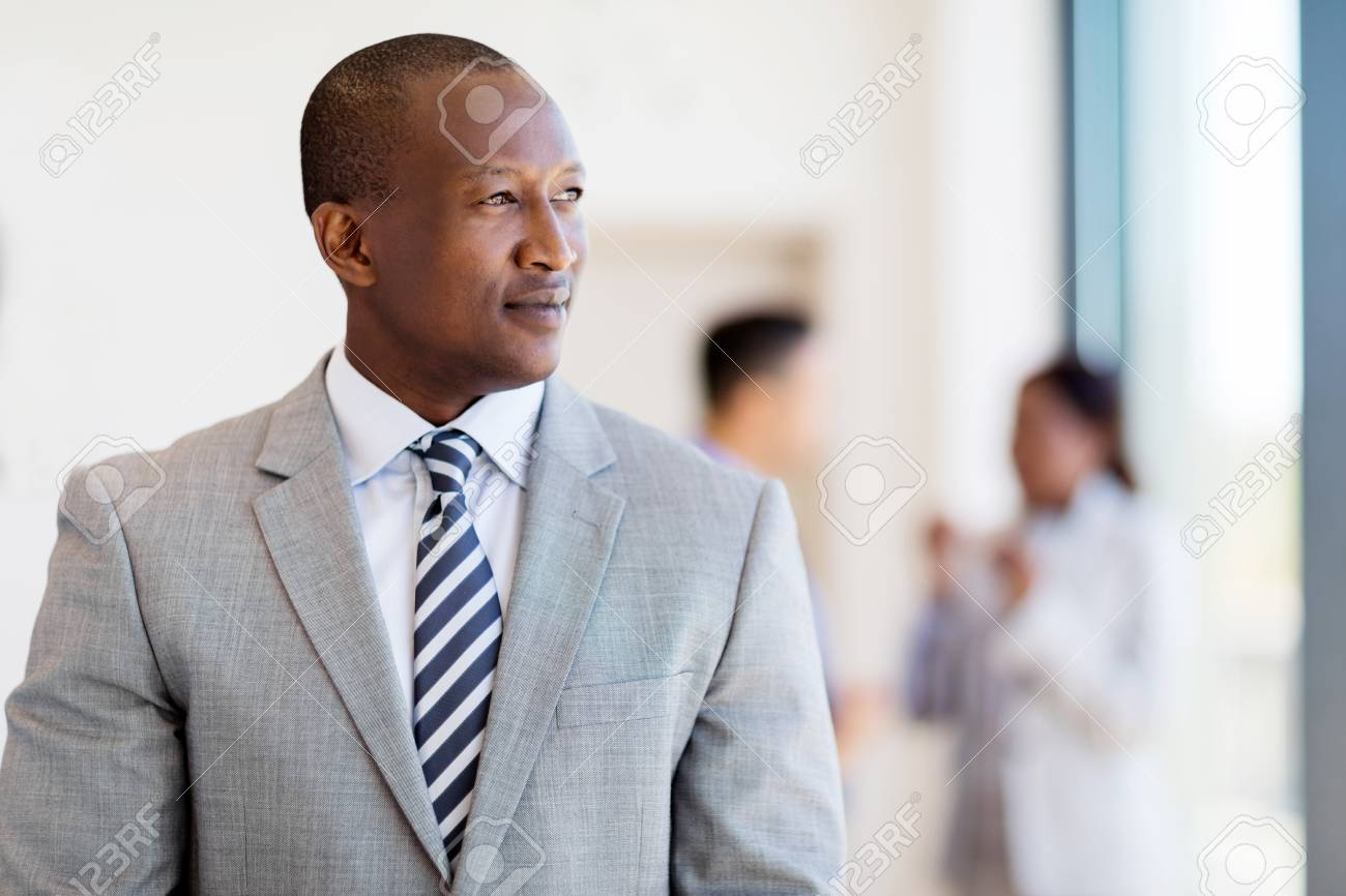 thoughtful afro american business man looking outside the window - 53100849
