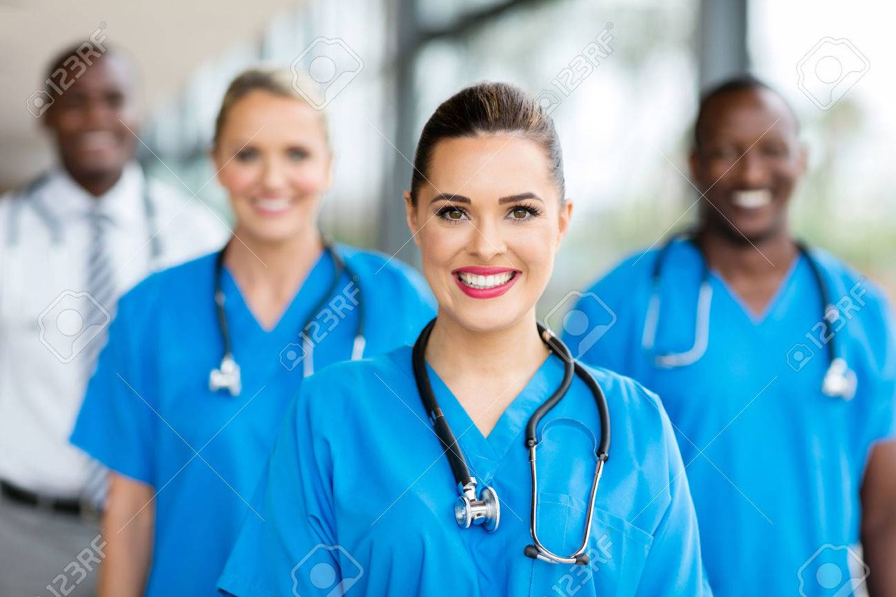 pretty medical nurse and colleagues in hospital - 54871548