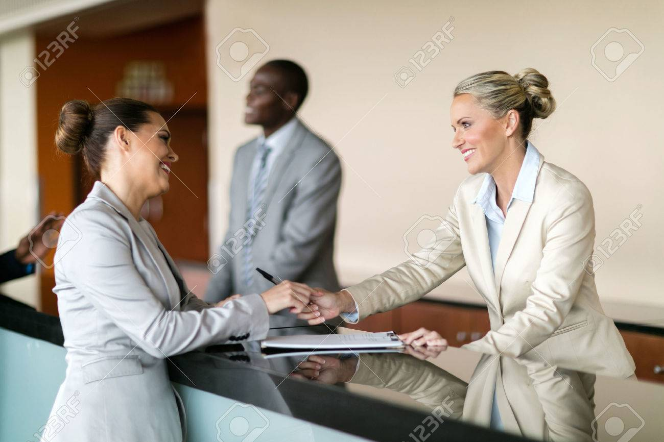 businessman check in at hotel reception - 54874168