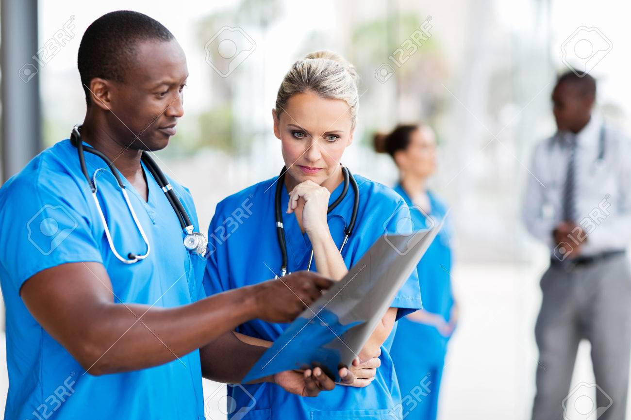 professional doctors studying x-ray film - 54874553