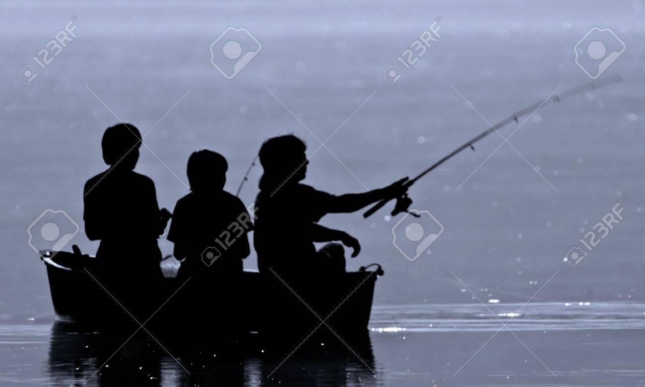 Three boys fishing from a boat in silhouette. Stock Photo - 8111898