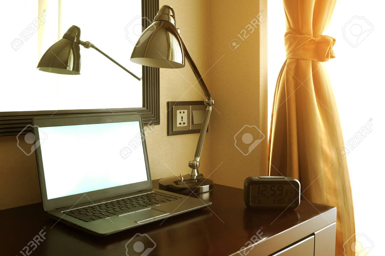 - Laptop Notebook Computer On Wood Dark Brown Working Desk With