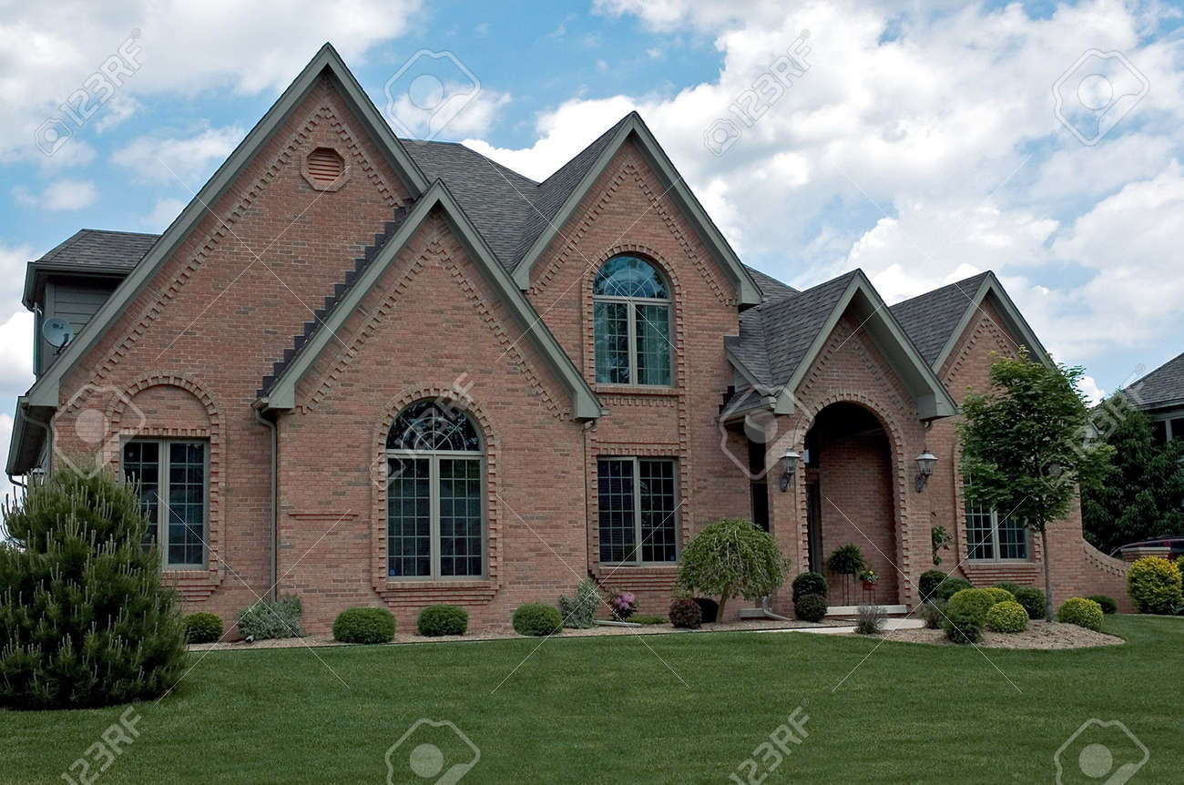 Fantastic detailed brickwork frames each window and the entranceway of this gorgeous home. Stock Photo - 227795