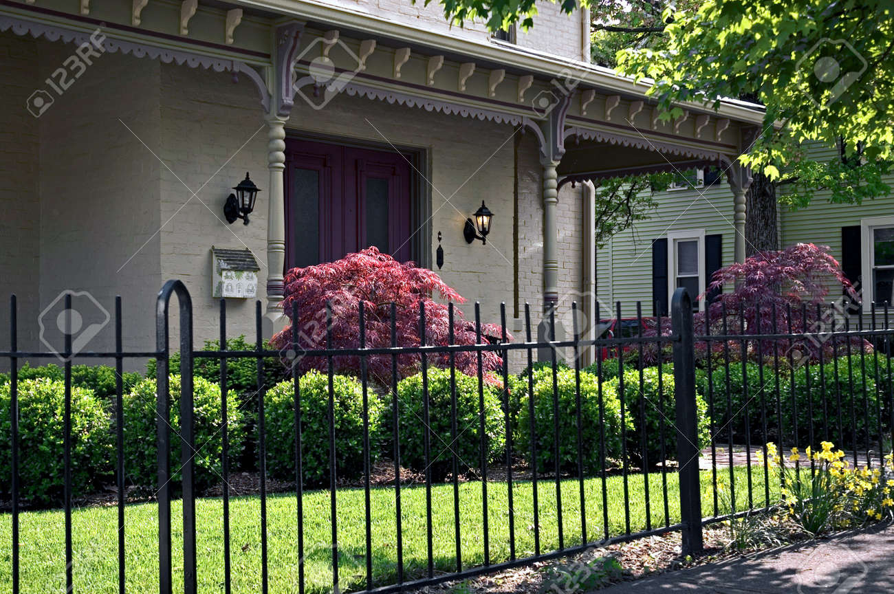 wrought iron fence victorian. Stock Photo - Wrought Iron Fencing And Ornate Victorian Roof Brackets Highlight This Elegant Front Entrance To Home. House Is Located In Historic Fence