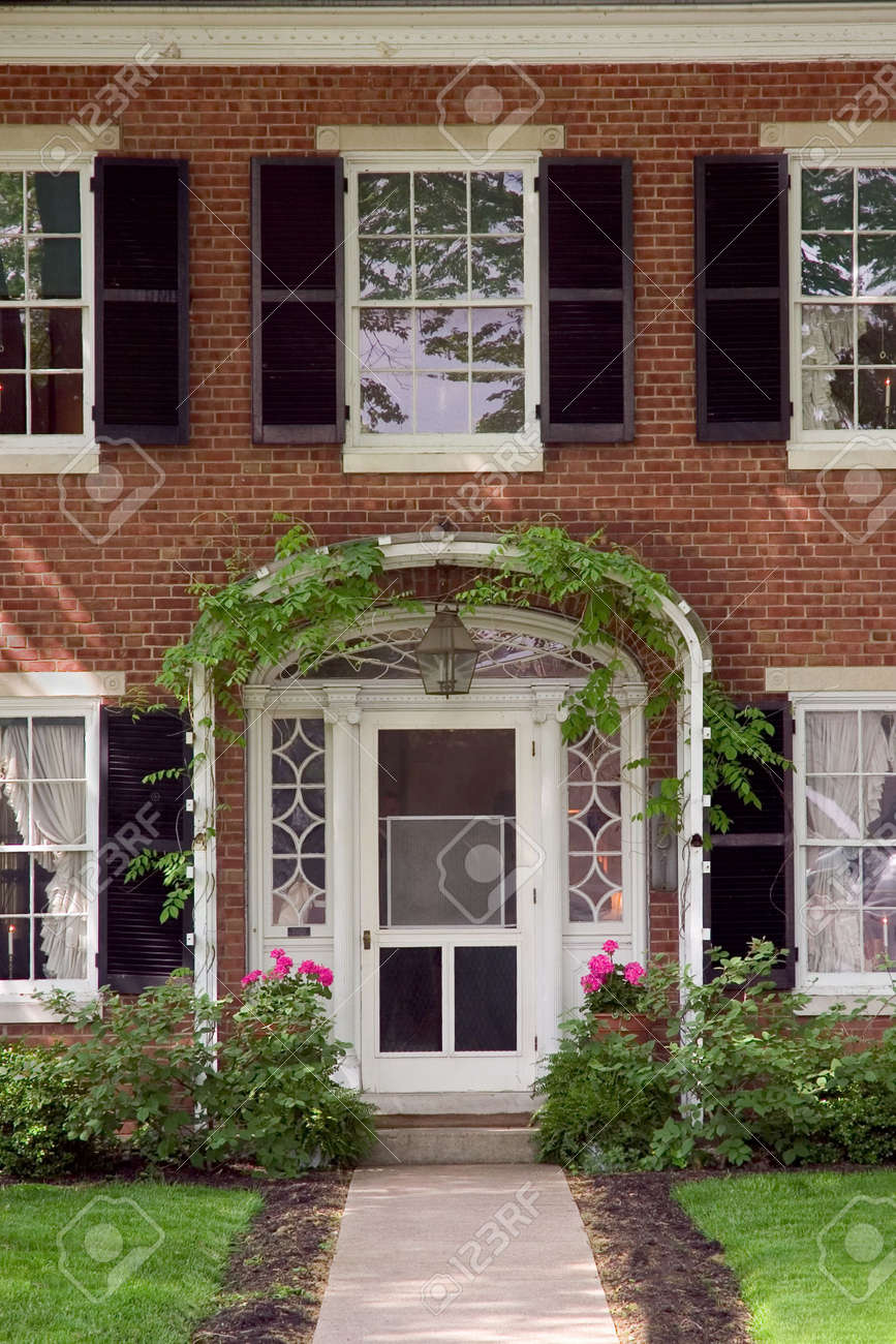 Elegant looking front door with an ivy trellis and flower pots. Stock Photo - 399825 & Elegant Looking Front Door With An Ivy Trellis And Flower Pots ...