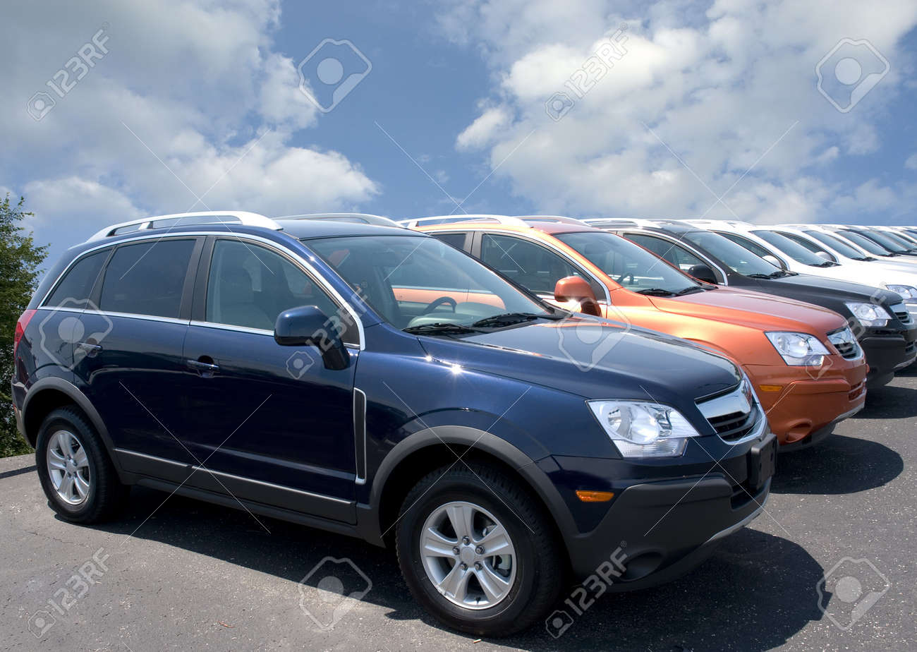 New fuel efficient SUV's on a car dealers lot for sale.  Stock Photo - 1297313
