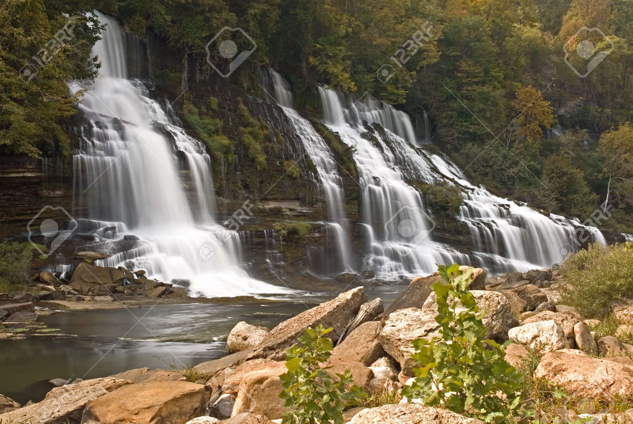A amazingly beautiful series of cascades down a gorge wall. The water source is an underground cavern which pours the water out the side of the gorge wall. The wall is filled with beautiful ferns and vines and the water stair steps its way down the wall. - 1954373