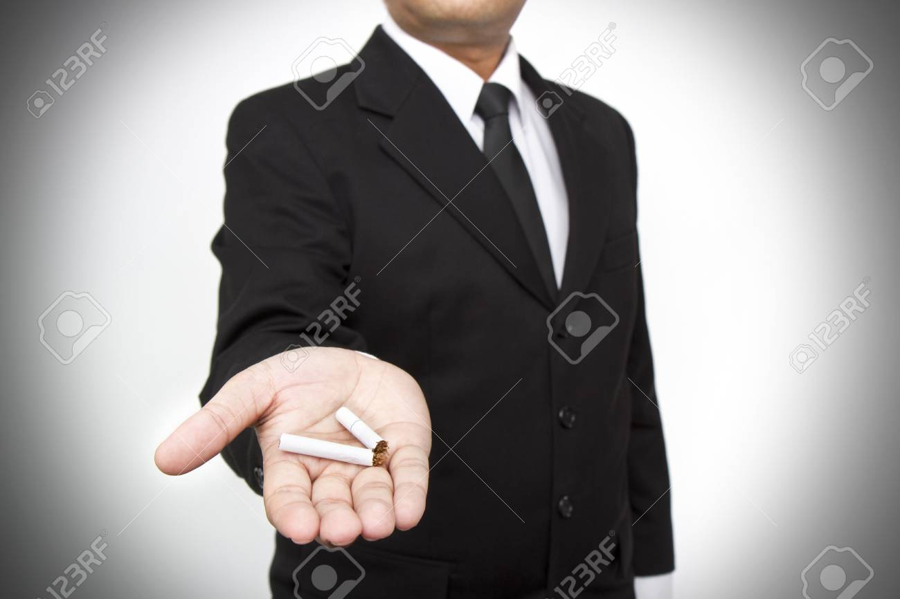 Quit smoking, human hands breaking the cigarette Stock Photo - 13589682