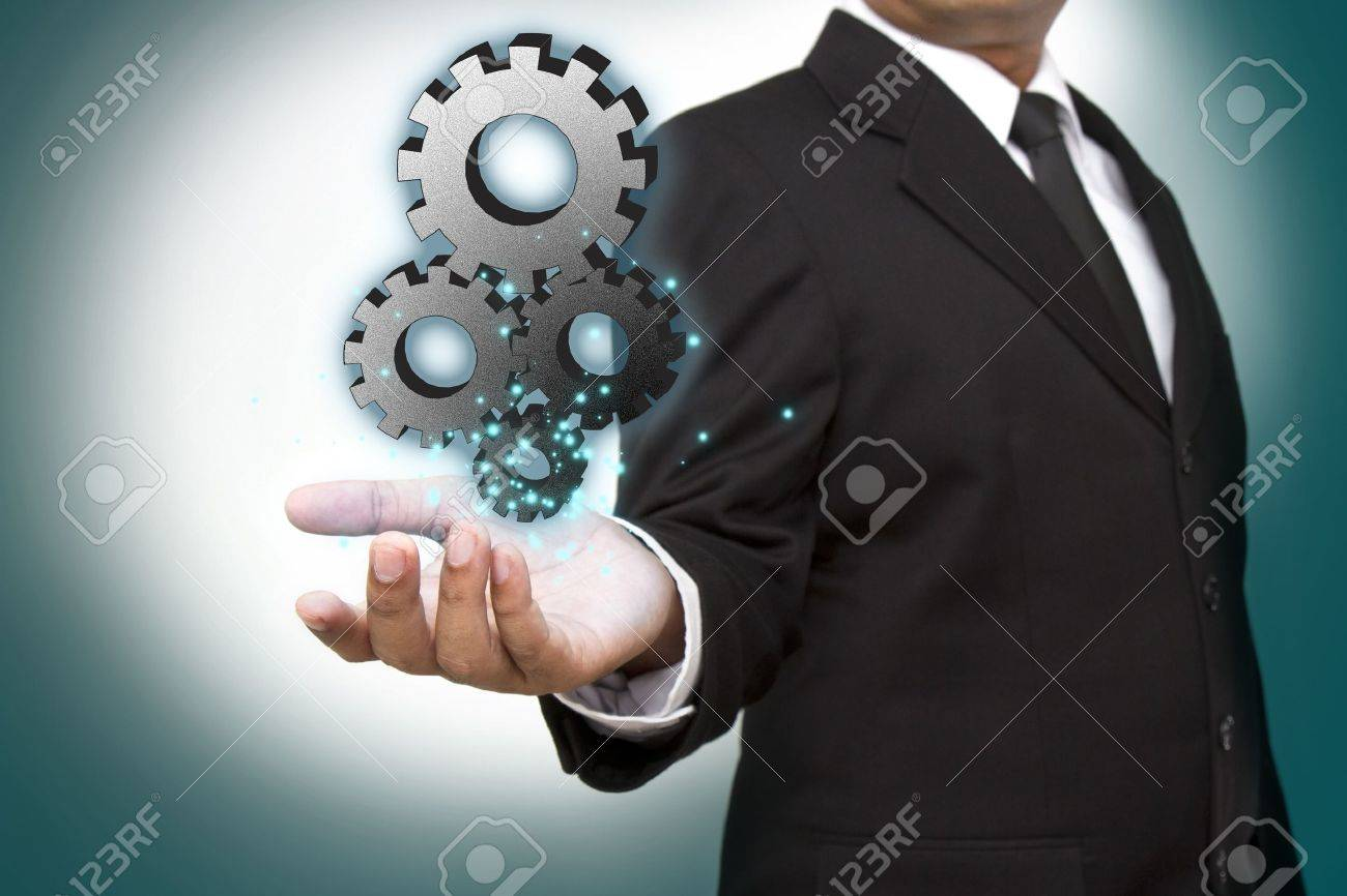 Businessman shows gear to success Stock Photo - 14938137
